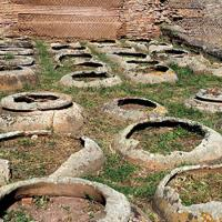 Lines of giant ceramic jars sunken into the earth