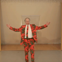 Man wearing a red suit, arms raised
