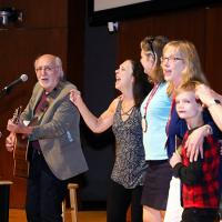 Peter Yarrow singing during Reunion 2019
