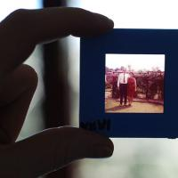 Fingers holding a photo of an elderly couple