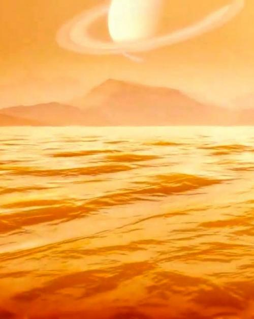 Bright gold sea with mountains in distance