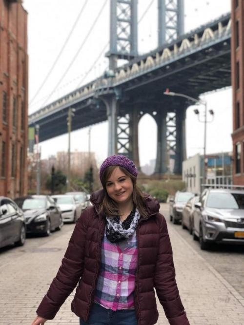 woman near NYC bridge