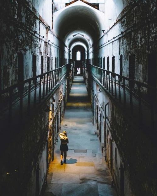 person walking down a dark alley
