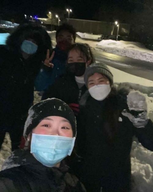 Students with masks on in snow