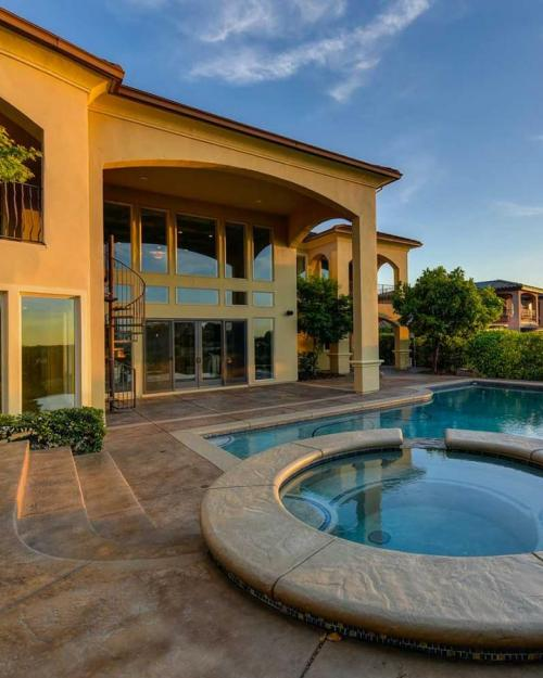 Mansion and pool at sunset