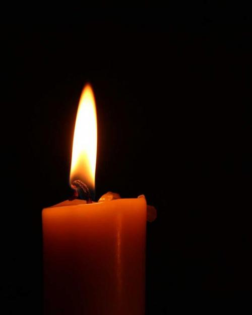 Candle and flame, dark background
