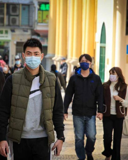 People walking on a city sidewalk