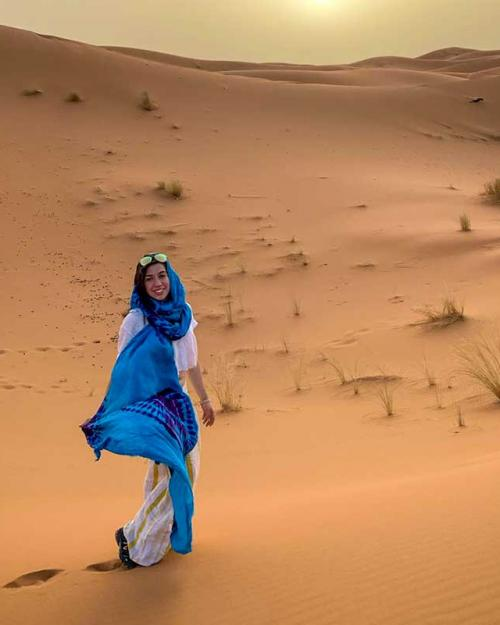 person wearing blue scarf in a desert
