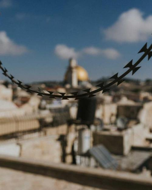 Wire up close; mosque in background