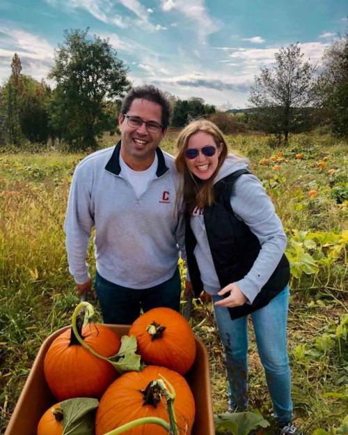 people in pumpkin patch