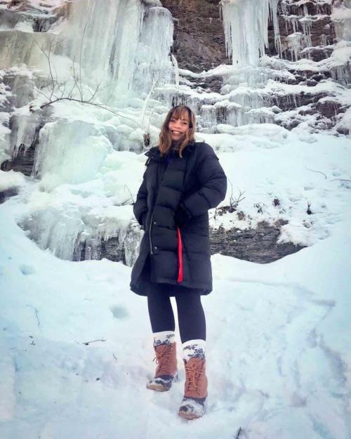 girl near icy waterfall