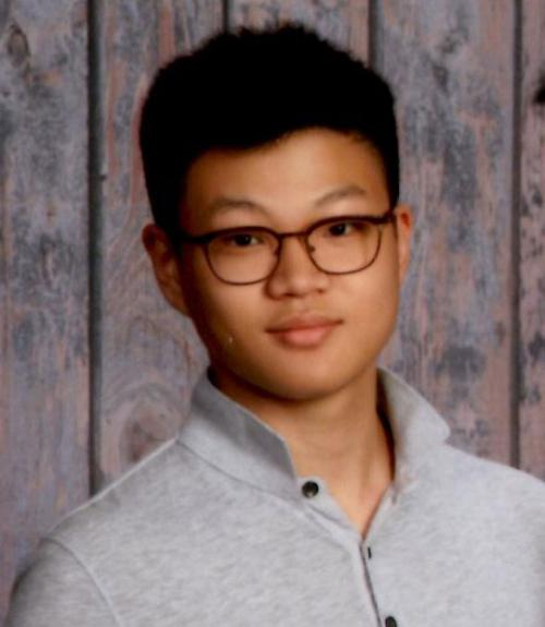 John Yoon in gray shirt with glasses.