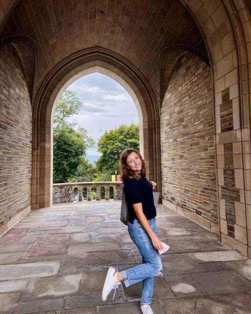 girl in Cornell archway