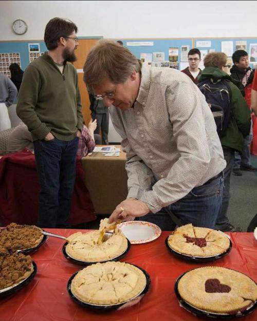 Person serving a piece of pie