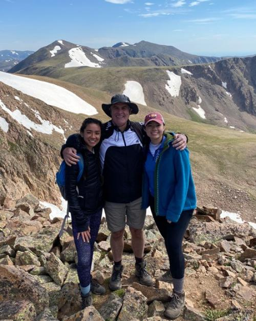 Three people in the mountians