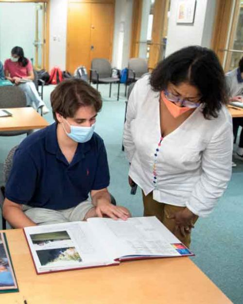 students look at a book