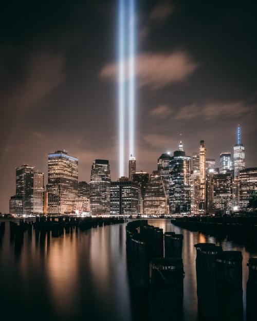 Beams of light memorializing the Twin Towers with the Manhattan skyline below.