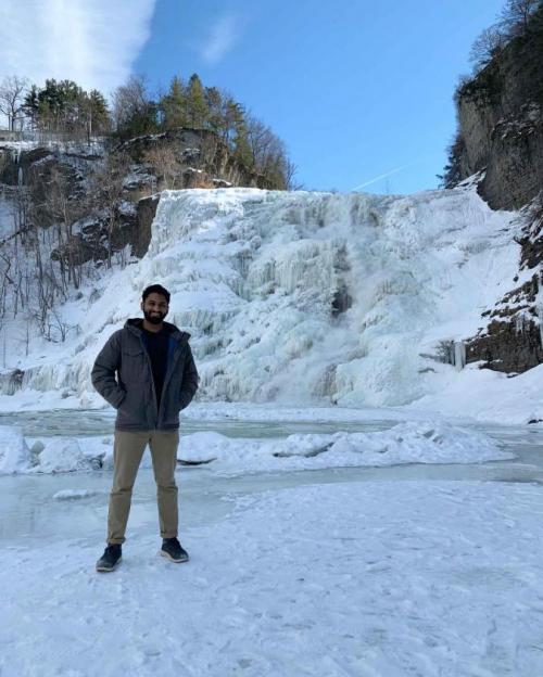 student at waterfall