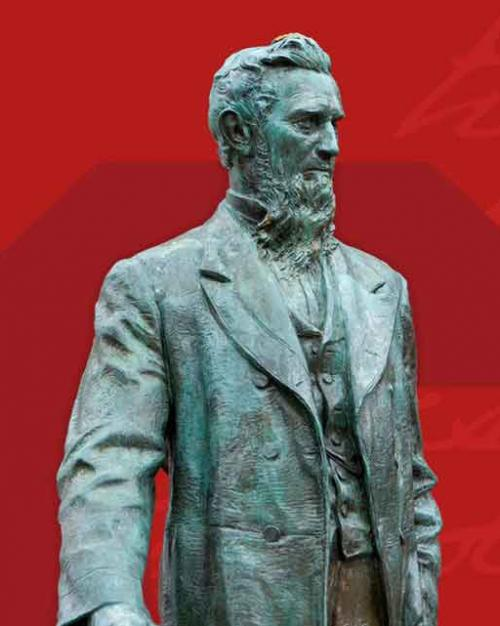 statue of Ezra Cornell against red background