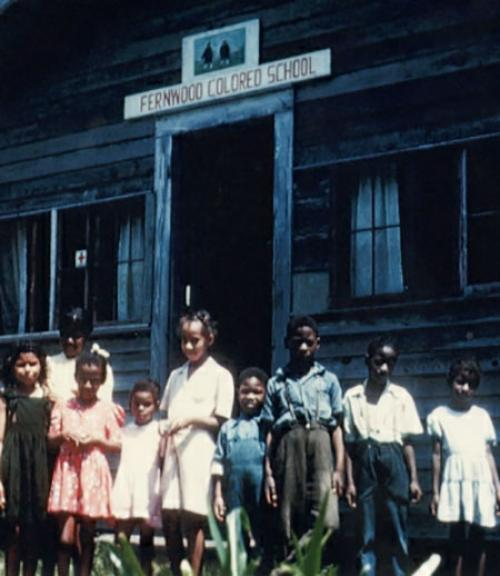 """African American children standing in front of the """"Fernwood Colored School"""""""