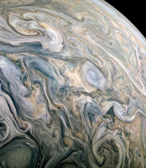 dense, gray swirls on the surface of a planet