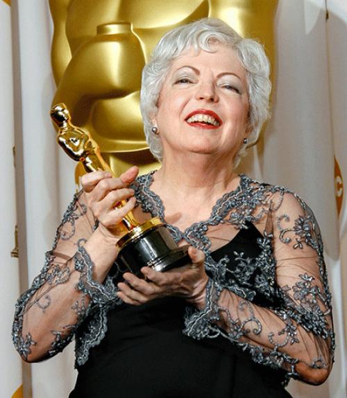 Thelma Schoonmaker holds an Oscar statuette.