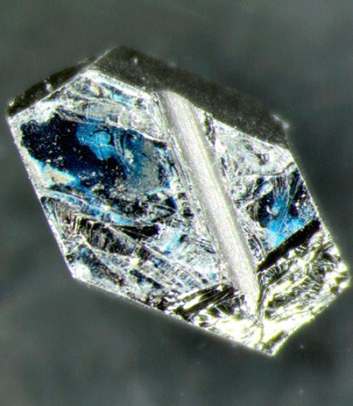 Hexagonal chip of uranium ruthenium silicide (URu2Si2)