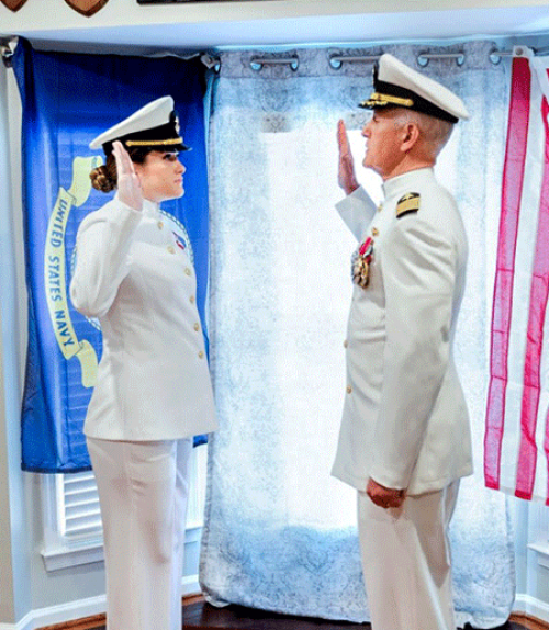 Two people in military uniform, facing each other