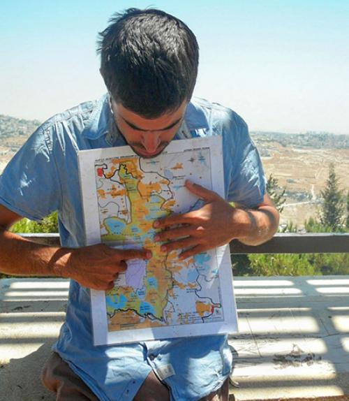 Person holds a map and points to it