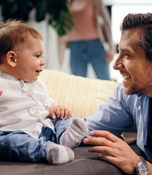Father smiling at baby