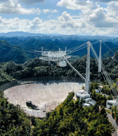 Large concrete dish set in lush hills