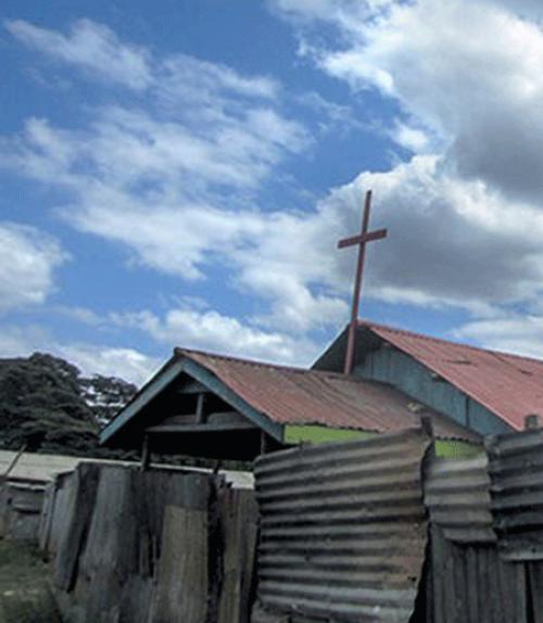 A cross above a church roof