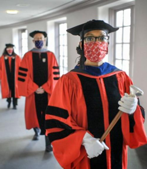 Three people in academic robes