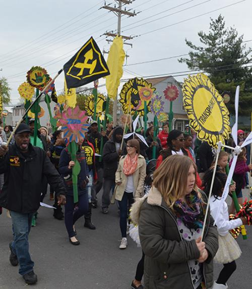 People march with colorful signs