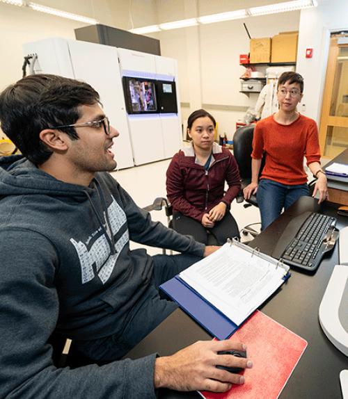 Molecular biologist Liz Kellogg and two students