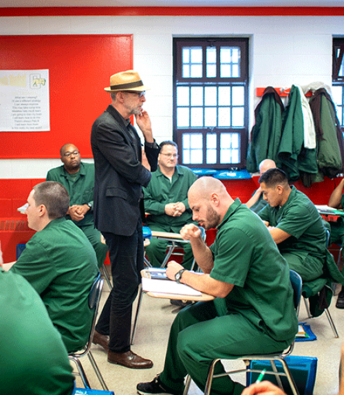 Professor Joe Margulies interacts with his students at Cayuga Correctional Facility in Moravia, New York