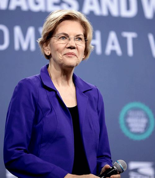 Senator Elizabeth Warren, smiling thoughtfully