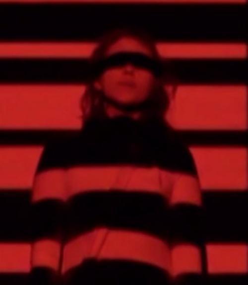 Image of Annie Lewandowski against red background