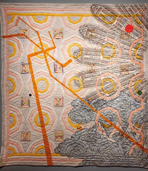 Quilt depicting orange lines and slave ships in a half circle facing out