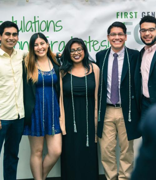first generation students pose for photos at graduation