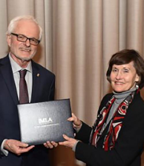 MLA President Anne Ruggles Gere presenting award to William Kennedy. Photo credit: Edward Savaria, Jr