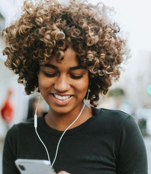 Woman listening to music on her iphone
