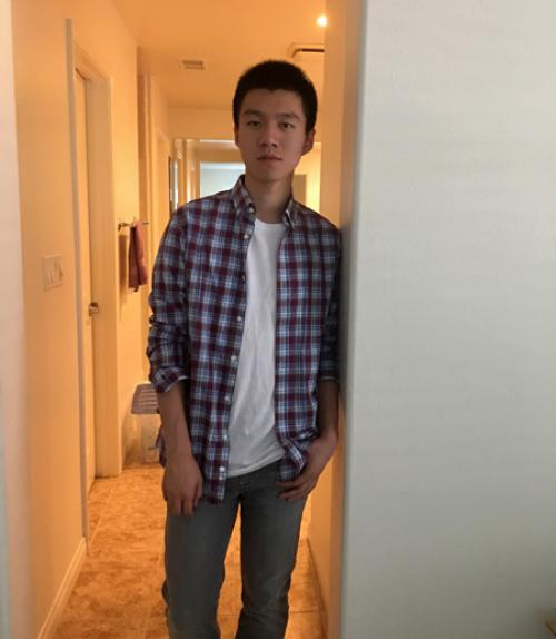 Yunxuan standing in a hallway