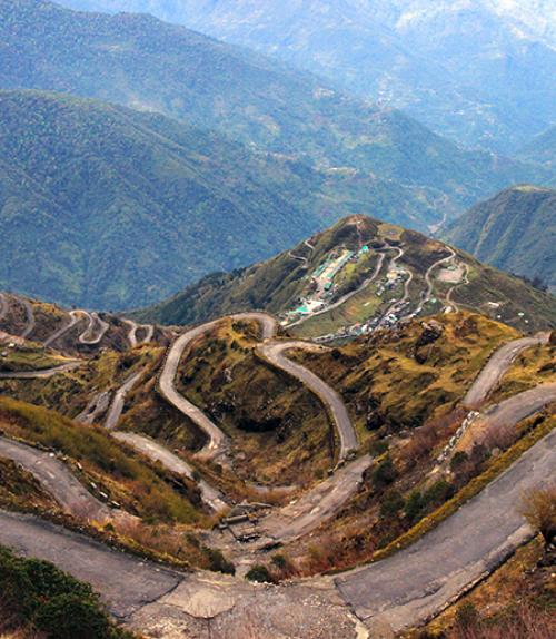 Winding road through mountains, seen from above