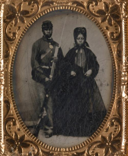 Portrait of a man with a bayonet and a woman