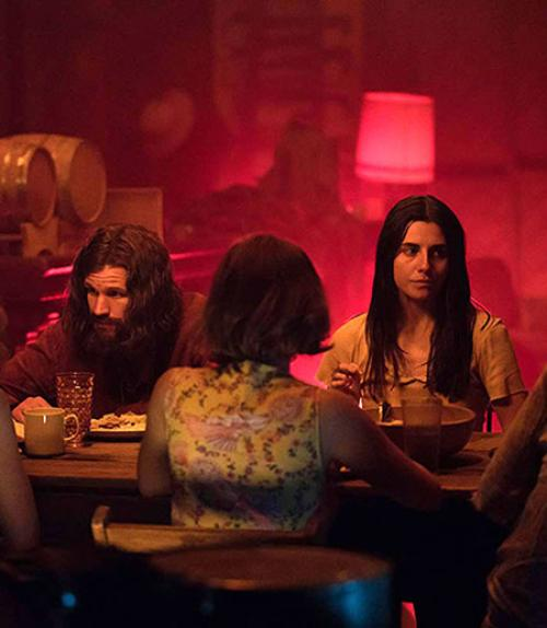 """A scene from """"Charlie Says"""" movie showing Charles Manson"""