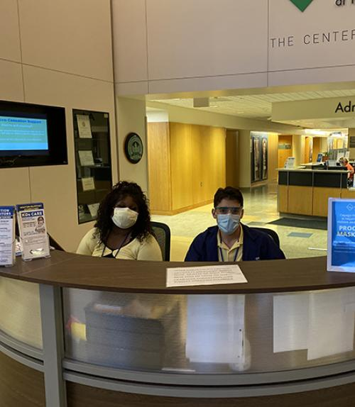 Workers with masks at Cayuga Medical Center