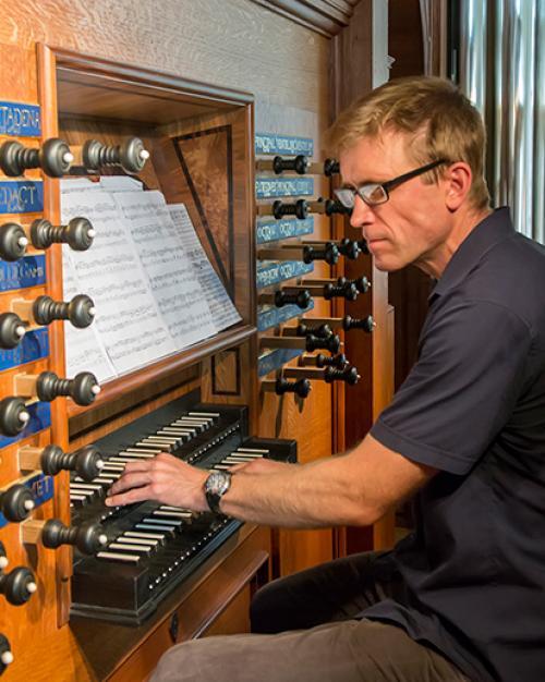 Person playing an organ