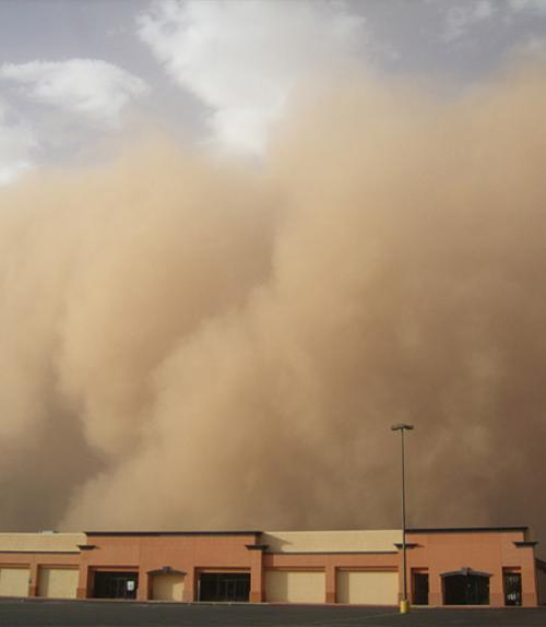 A dust storm engulfs a building