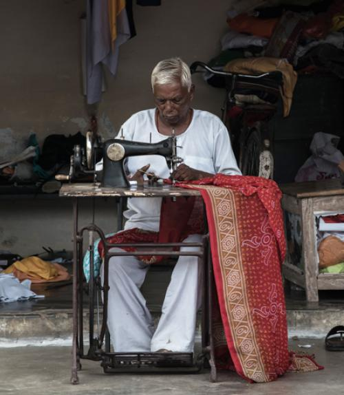 A woman sewing in India